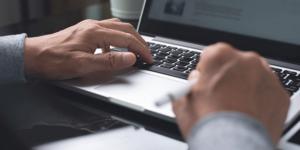 man hands typing on laptop computer keyboard